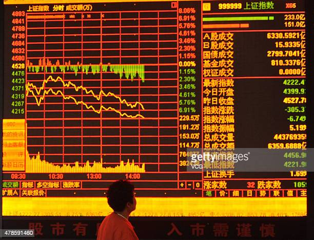 An investor observes stock market at a stock exchange hall on June 26 2015 in Fuyang Anhui province of China Chinese stocks dropped sharply on Friday...
