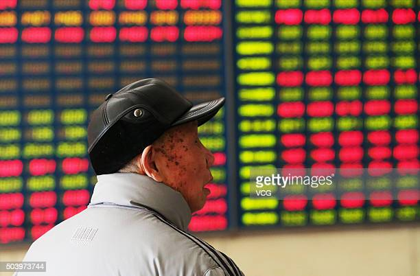 An investor observes stock market at an exchange hall on January 8 2016 in Nantong Jiangsu Province of China Chinese stock market experienced a halt...