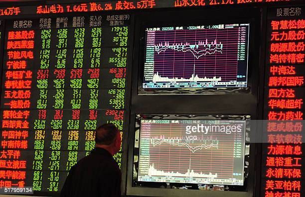 An investor observes stock market at an exchange hall on March 29 2016 in Fuyang Anhui Province of China The Shanghai Composite Index dropped 3799...