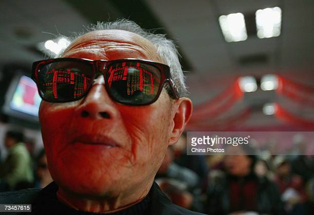 An investor views stock index on an electronic share price board at a securities company on March 1 2007 in Nanjing of Jiangsu Province China China's...