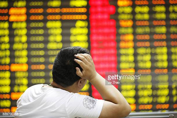An investor watches the eclectic monitor at a stock exchange in Huaibei Anhui province China on 7th July 2015 The Shanghai Composite shed as much as...
