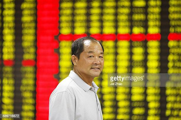 An investor watches the eclectic monitor at a stock exchange in Huaibei Anhui province China on 24th August 2015Chinese stocks plummeted Monday...