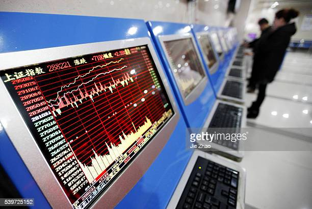 An investor watchs the electric board in a stock market in Huaibei Anhui province east China on 14th March 2016The Shanghai Composite Index advanced...