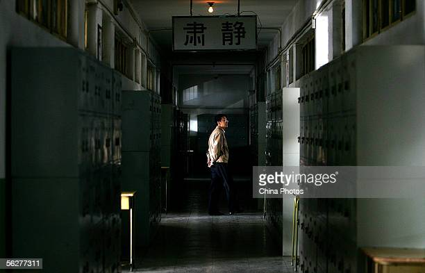 An invigilator walks out of an examination room during the national civil servant qualification exam November 26 2005 in Beijing China Some 365000...