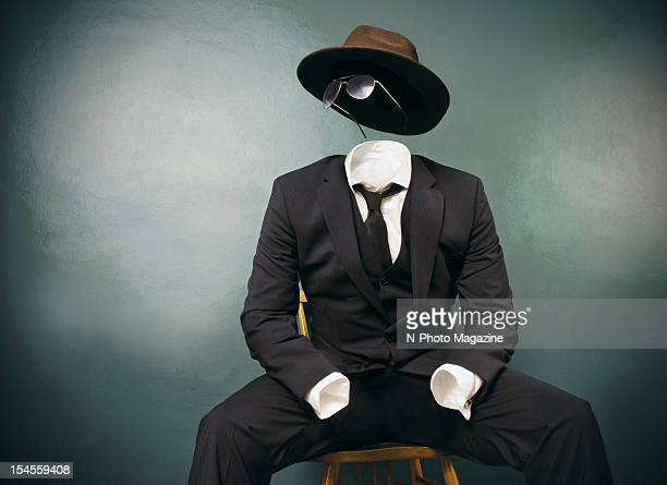 This image has been digitally manipulated An invisible man in a suit dark glasses and fedora taken on April 12 2012