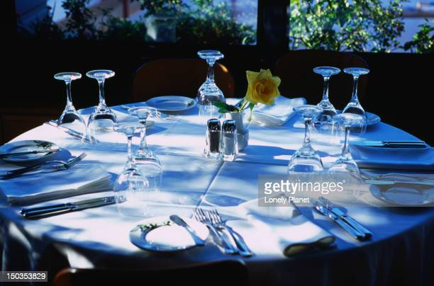 an invitingly set outdoor table at the olive garden restaurant in the titania hotel, omonia, athens. - olive garden stock photos and pictures