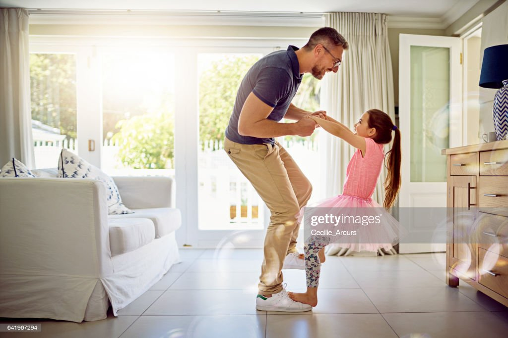 An involved father is an influential father : Stock Photo