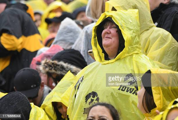 An Iowa fan came prepared for the light rain that fell throughout the game during a Big Ten Conference football game between the Purdue Boilermakers...