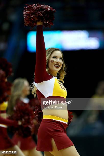 An Iowa State Cyclones cheerleader cheers in the second half against the Nevada Wolf Pack during the first round of the 2017 NCAA Men's Basketball...