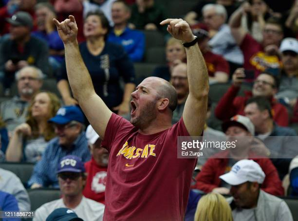 An Iowa State Cyclones fan reacts after it was announced that fans will not be permitted to the rest of the Big 12 Basketball Tournament after...