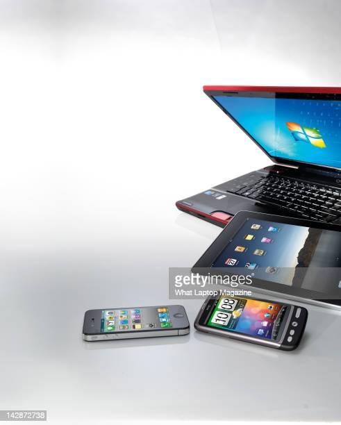 An iPad iPhone smartphone and a laptop July 29 2011