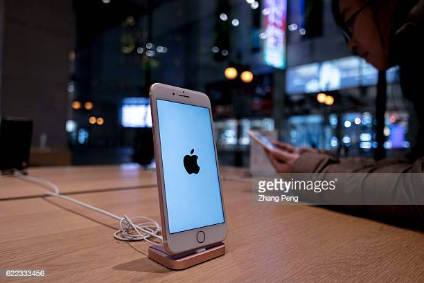 An iPhone 7 is exhibited in an Apple Store Because of the competition from the domestic brands like Xiaomi and Huawei the demand for Apple's new...