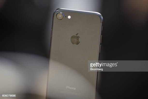 An iPhone 7 smartphone is displayed at an Apple Inc in New York US on Friday Sept 16 2016 Shoppers looking to buy Apple Inc's new iPhone 7...
