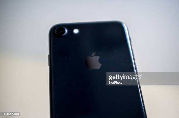 An iPhone 8 is pictured under charge London on January 13 2018 Apple now under pressure from both sides of Atlantic over admission it slows phones...