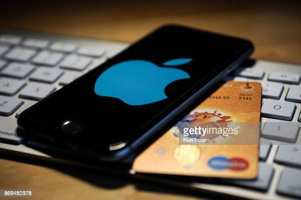 An iPhone and a debit card are seen on November 2 2017