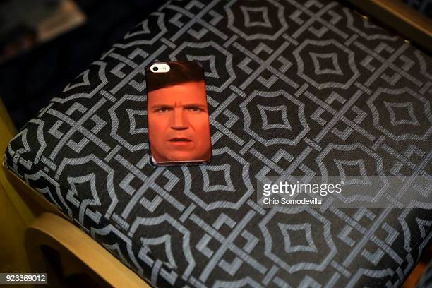 An iPhone case with Tucker Carlson's face is left in a chair during the Conservative Political Action Conference at the Gaylord National Resort and...