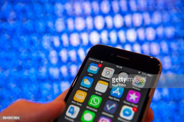 An iphone homescreen with a binary background is seen in this photo illustration on July 9, 2018.