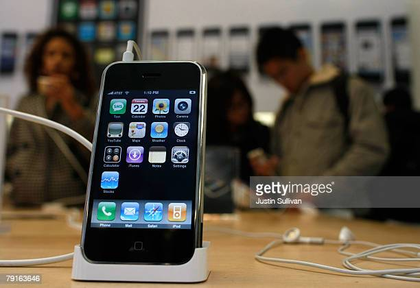 An iPhone is displayed at an Apple Store January 22 2008 in San Francisco California Apple Inc reported a 57 percent surge in firstquarter profit...