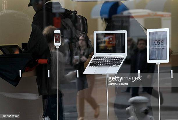 An iPhone MacBook Air and iPad 2 are displayed at an Apple Store on January 24 2012 in San Francisco California Apple will report first quarter...