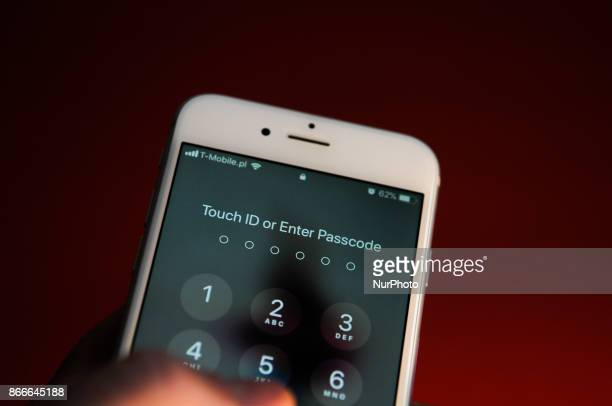 An iPhone prompting to enter the passcode is seen on October 25 2017