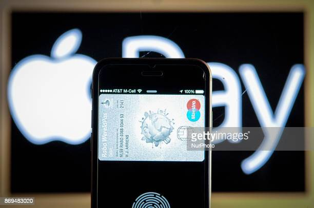 An iPhone with a simulated Apple Pay screen is een in this photo illustration on November 2 2017