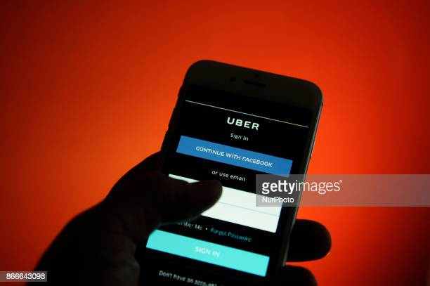 An iPhone with an Uber application login screen on October 25 2017