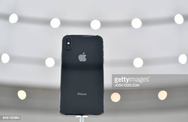 An iPhone X is seen on display during a media event at Apple's new headquarters in Cupertino California on September 12 2017 / AFP PHOTO / Josh...