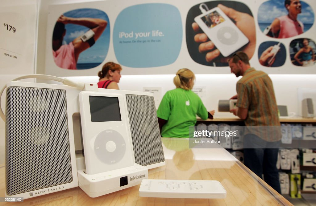An iPod and speaker set stands on display at the Apple Store