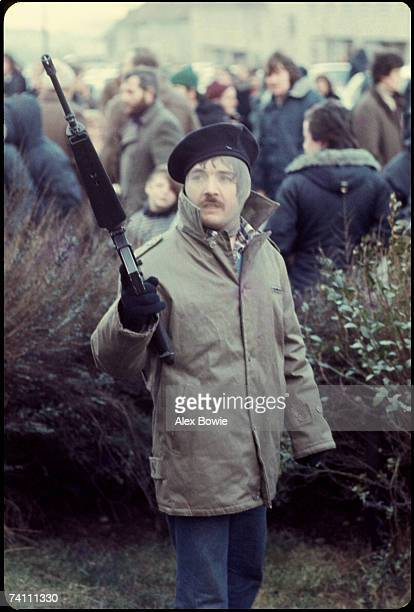 An IRA gunman in the republican Creggan estate in Londonderry during a demonstration to mark the 6th anniversary of Bloody Sunday 30th January 1978...