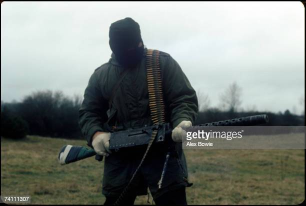 An IRA gunman with a World War II vintage machine gun during a training and propaganda exercise in Northern Ireland 12th February 1977