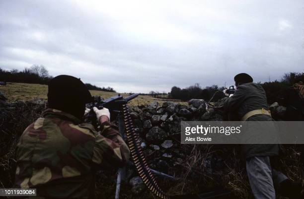 An IRA gunmen with a Browning 50 caliber heavy machine gun during a training and propaganda exercise in Northern Ireland 12th February 1977