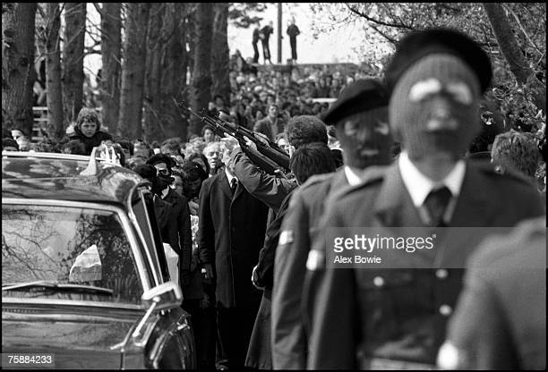 An IRA honour guard fire a salute at IRA hunger striker Francis Hughes' funeral in Bellaghy in County Londonderry 15th May 1981 Hughes was the second...