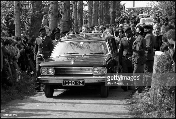 An IRA honour guard leads the funeral cortege of IRA hunger striker Francis Hughes in Bellaghy in County Londonderry 15th May 1981 Hughes was the...