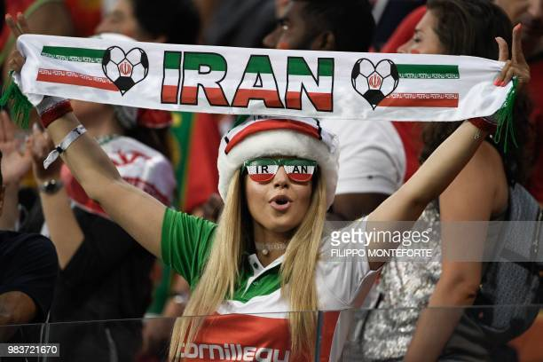 An Iran fan cheers prior to the Russia 2018 World Cup Group B football match between Iran and Portugal at the Mordovia Arena in Saransk on June 25,...