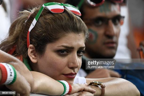 An Iran fan reacts after the Russia 2018 World Cup Group B football match between Iran and Portugal at the Mordovia Arena in Saransk on June 25 2018...