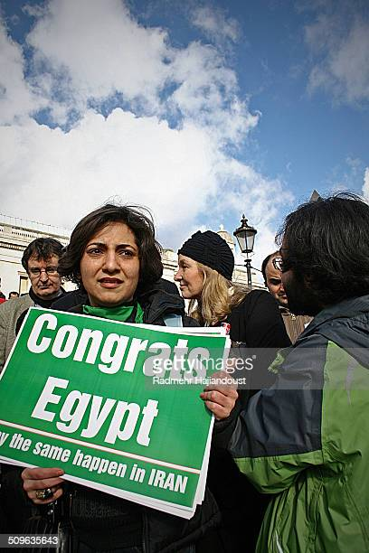 An Iranian activist holding a sign congratulating Egypt in an Amnesty International held event in support of Egyptians's bringing down the Mobarak...