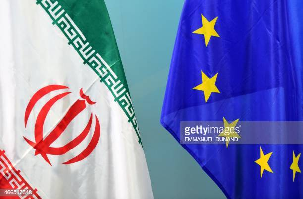 An Iranian and a European flag are set on March 16 2015 ahead of nuclear talks between European foreign ministers and their Iranian counterpart at...