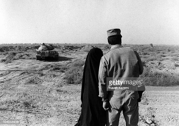 An Iranian army colonel shows a knocked-out Iraqi tank to a woman, near Susangerd, Iran, during the Iran-Iraq War, 23rd August 1981.