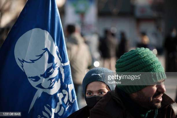 An Iranian boy holds a flag with a portrait of the former Iranian commander of the Islamic Revolutionary Guard Corps Quds Force, General Qasem...