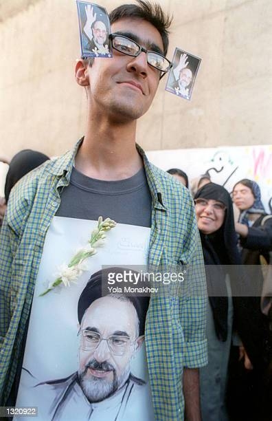 An Iranian boy, Kove Meshka,18 years-old, celebrates what many foresee as a victory for incumbent Iranian President Mohammad Khatami a day after the...