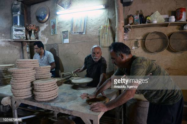An Iranian ceramist works on a pot at a pottery in Lalecin Hamadan Iran on August 27 2018 Lalecin citizens maintain the pottery tradition with...