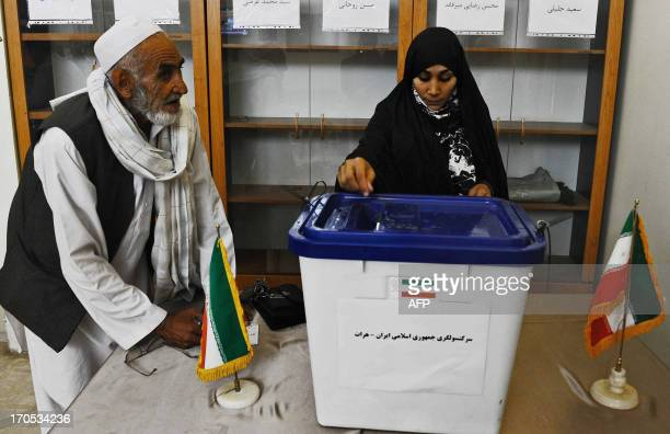 An Iranian citizen casts her ballot to elect a new Iranian president at the Iranian consulate in Herat on June 14 2013 Iranians were voting June 14...