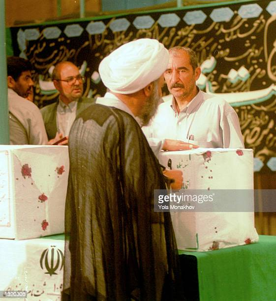 An Iranian cleric casts his vote in the presidential election at the Hosseinieh Jamaran mosque June 8, 2001 in northern Tehran, Iran. President...
