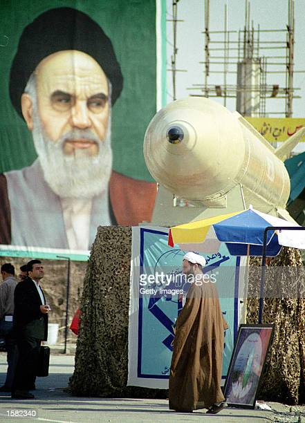 An Iranian cleric walk uder the Shahab 3 missle during a military parade November 1 2002 in Tehran Iran Iran's missile program is creating worries...