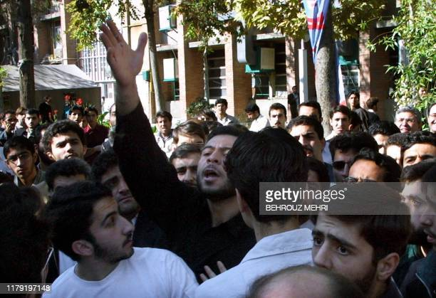 An Iranian conservative student objects to a speech delivered by a reformist student during a demonstration in support of Hashem Aghajari a popular...