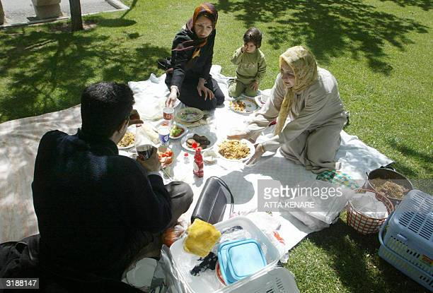 An Iranian family enjoy a picnic in central Tehran's Shaghayeq park 01April 2004 on 'Sizdah bi Dar' the thirteenth day of Noruz or the Iranian New...