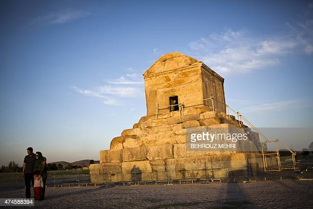 An Iranian family poses for a picture on May 19 next to the tomb of Cyrus II of Persia known as Cyrus the Great the founder of the Persian Achaemenid...