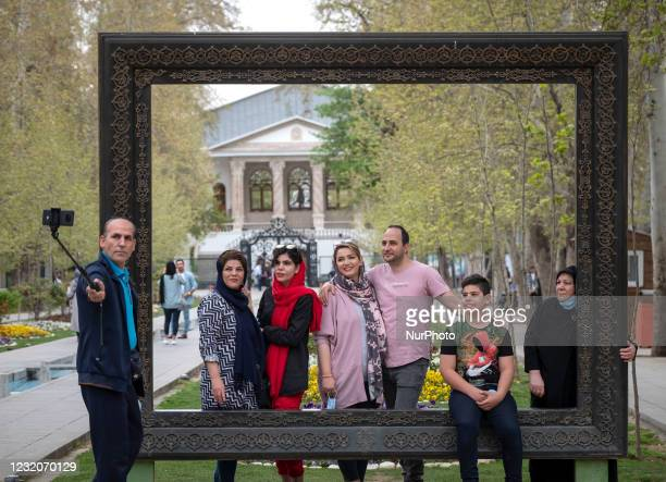 An Iranian family who none of them wearing protective face mask, take a selfie as they stand out of the Cinema Museum in northern Tehran during the...