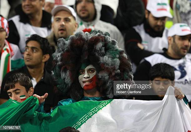 An Iranian fan cheers prior to the AFC Asian Cup Group D match between Iran and Iraq at the Al Rayyan Stadium on January 11 2011 in Doha Qatar