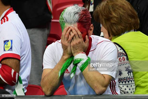 An Iranian fan reacts after the teams defeat during the Russia 2018 World Cup Group B football match between Iran and Spain at the Kazan Arena in...